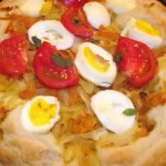 Simple and fast pie with braised cabbage, eggs, tomato and lemon basil..
